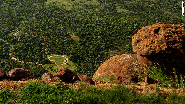 To play the 19th hole at Legends Golf Resort in South Africa you have to take a helicopter to the tee, which is perched on top of a mountain. The green below is in the shape of Africa.