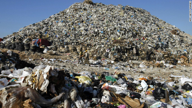 Men walk past a huge mound of garbage, piled up along the southern coastal Lebanese city of Sidon in 2008. 'Sidon's mountain' is an immense landfill that dumps its trash into the Mediterranean, polluting the coast of the ancient Phoenician port city. The dump is just a few metres away from the tourist sites of the southern city of Sidon -- its crusader sea castle, ancient vaulted souk and Phoenician temple.