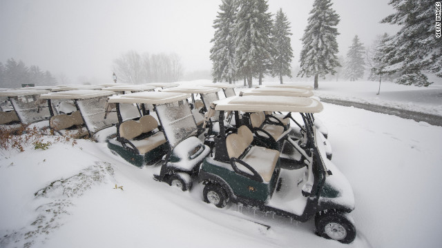 Golf carts sit under a blanket of snow at the Seven Springs Golf Course.