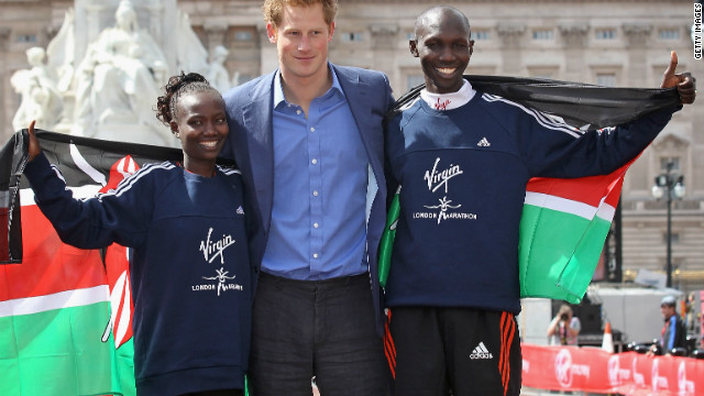 Prince Harry celebrates with marathon winners Mary Keitany and Wilson Kipsang, both of Kenya. Claire Squires had been less than a mile from the finishing line at The Mall when she collapsed and died.