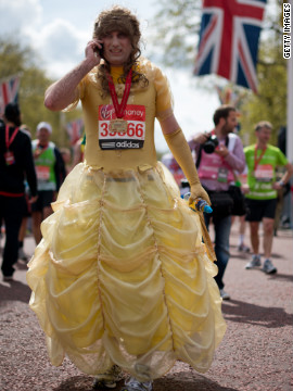 A man in a dress catches his breath after crossing the line at the 2012 London Marathon. He was one of many runners to dress up at the event for charity.<br/><br/>