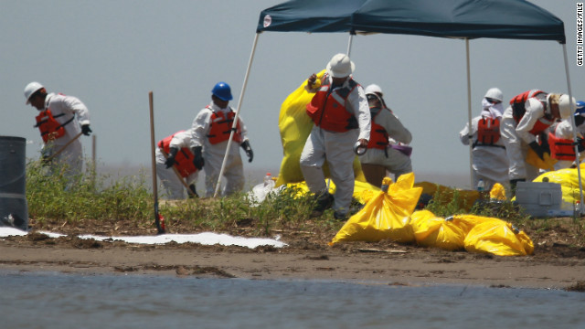 Workers clean a beach in South Pass, Louisiana, in May 2010 after the Deepwater Horizon explosion and spill.
