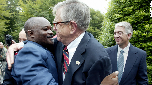 Former inmate Robert Sutten, left, hugs Chuck Colson, founder of Prison Fellowship, at the White House in 2003.