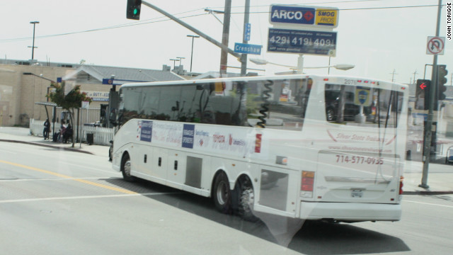 A bus winds its way through south Los Angeles during Operation Hope's economic empowerment tour.