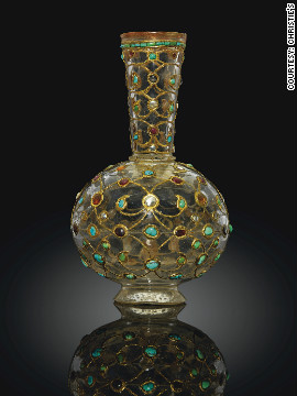This gem set rock crystal bottle was up for auction at Christie's. Encrusted with gold and precious stones, it dates back to 17th century Mughal India.