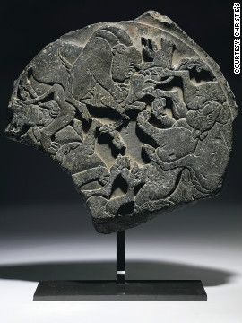 This grey schist roundel is carved with a scene of lions and deer. It dates back to 15th century Iran, and was offered for sale at Christie's.