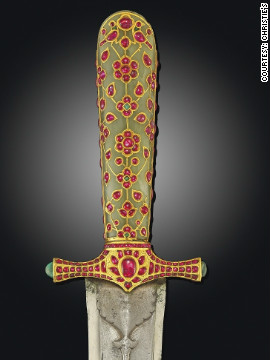 This 16th-century Ottoman sword, decorated with gold and inlaid with precious stones, was one of a number of ornate weapons to go under the hammer at Christie's.