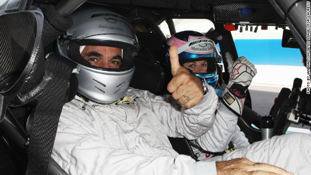 In the driver's seat: Wolff with tennis player Mansour Bahrami at the 2010 Laureus Sports Awards in Abu Dhabi. 