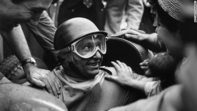 Fangio is mobbed by fans after winning the 1955 Italian Grand Prix. The racing legend had 24 wins and five world championships in a career spanning almost 20 years.<br/><br/>