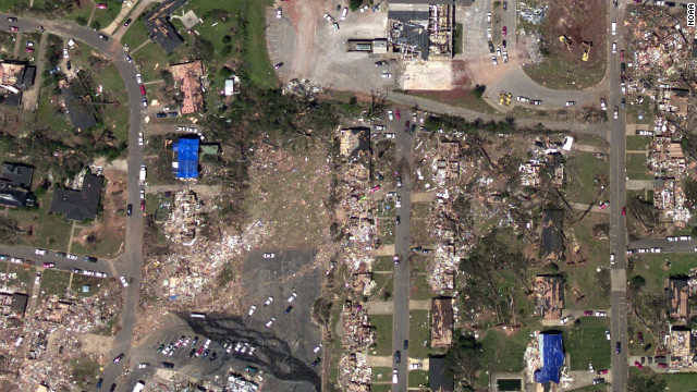 And this photo, taken by the National Oceanic and Atmospheric Administration's National Geodetic Survey just days after the tornado, shows the damage to the same neighborhood.