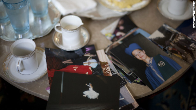 Photographs of Angeliki on the table of her family home in Aigio, on Greece's Peloponnese Peninsula. 
