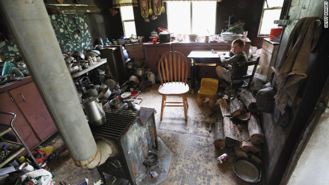 A boy sits in his uncle's home April 21 in Owsley County, Kentucky, where 44.5% of residents live below the poverty line. 