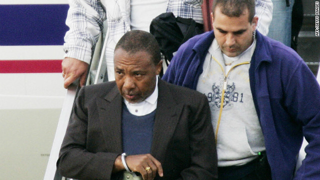 Charles Taylor arrives at Rotterdam Airport in June 2006 for his war crimes trial following his arrest in Nigeria.