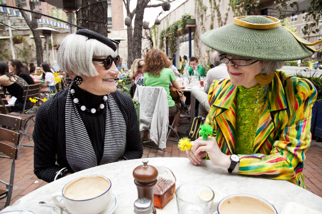 Valerie and Jean, a pair of bloggers known as the Idiosyncratic Fashionistas, share a moment over breakfast.