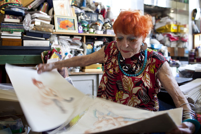 Ilona Royce-Smithkin, 92, goes through a series of nude drawings she has done over the years.