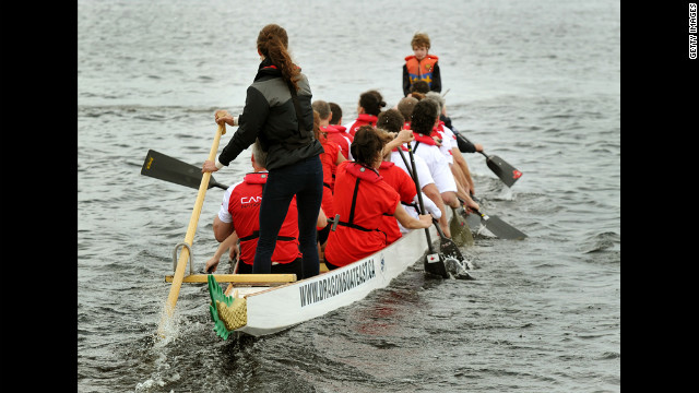 Catherine steers a dragon boat before a race against her husband on Dalvay Lake.