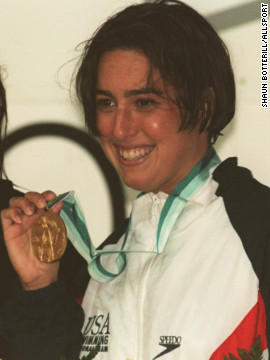 "A 23-year-old Evans shows off her gold medal after winning the 800 meter freestyle at the World Swimming Championships in Rome, 1994. She was known for her ""unorthodox windmill"" stroke, as she puts it."