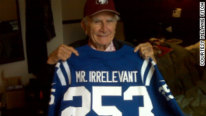 Paul Salata holds up this year\'s Mr. Irrelevant jersey in a New York hotel room.