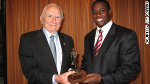 Salata presents the Houston Texans\' Cheta Ozougwu with the 2011 honor last year.