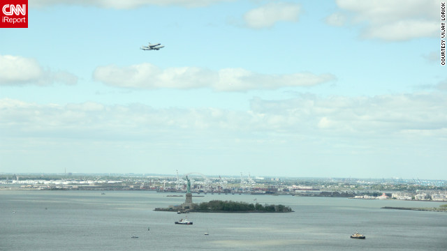 Vijay Lorick captured this image of the shuttle over the Statue of Liberty from the 27th floor of his office building in downtown New York. &quot;Since Monday we've been trying to figure out when it's coming since we do have a great view,&quot; he said.