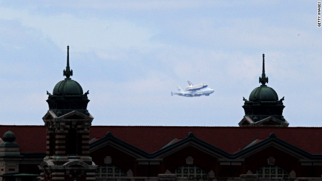 The Enterprise and 747 are seen behind Ellis Island on the shuttle's final flight Friday.