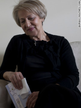 Angeliki's mother Tota, photographed at the family home in Aigio on March 31, 2012, remembers her daughter.