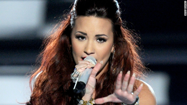Demi Lovato fans rush stage, pause concert