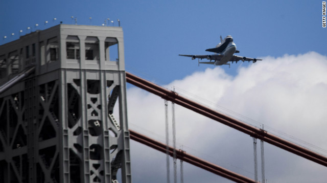 The Enterprise passes over the George Washington Bridge prior to landing at John F. Kennedy International Airport on Friday.