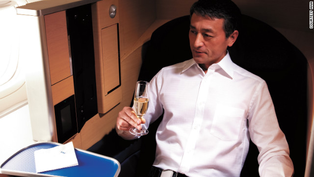 ANA's 777 flights between New York and Tokyo have high-tech aluminum cubicles that feature laptop drawers.