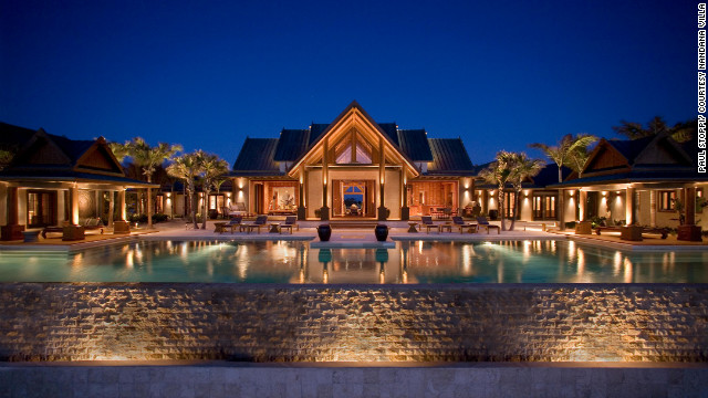 The 20,000-square-foot Nandana is on five private acres of Bahamian beachfront and has a 120-foot-long infinity pool that anchors five luxurious suites.&lt;br/&gt;&lt;br/&gt;&lt;br/&gt;&lt;br/&gt;&lt;a href='http://www.departures.com/slideshows/worlds-most-opulent-villas/6?cnn=yes' target='_blank'&gt;See more opulent villas at Departures.com&lt;/a&gt;