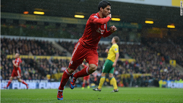 Luis Suarez scored with a memorable long-range effort as Liverpool beat Norwich City on Saturday.