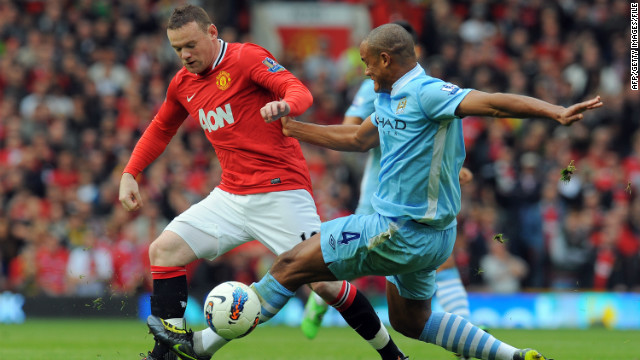 Wayne Rooney, left, and Vincent Kompany did battle in October's Manchester derby, which City won handily 6-1.