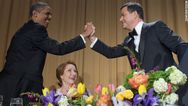 Host Jimmy Kimmel gives President Obama a high five after Kimmel finishes his speech at the White House Correspondents' Association Dinner on Saturday, April 28, 2012.