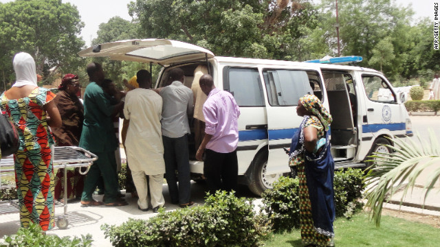 An injured victim is brought to a hospital in Kano, Nigeria, after gunmen attacked Christians worshipping on a university campus.