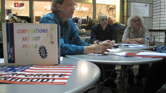 John Steefel, Rick Theis and Mike Korn from Restore Democracy group meet regularly at a public atrium on Wall Street.