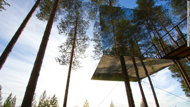 "The Ice Hotel isn't the only quirky accommodation Lapland has to offer. In recent years a series of ""Tree Hotels"" have popped up in the pristine forests of Harads, near the Lule river. This ""Mirrorcube"" room almost disappears into the landscape, while an adjacent treehouse in the shape of a UFO is a little more conspicuous."