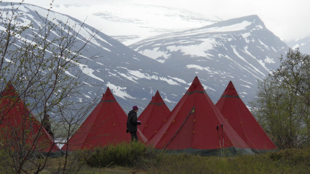 "A group of determined trekkers set up camp at the foot of Kebnekaise, Sweden's highest mountain. It's just one of the stops along the mammoth ""King's Trail"" that stretches for 440 kilometers."