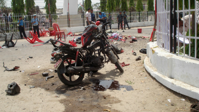 The scene a blast where a bomb attached to a motorbike exploded killing protesters in the southern city of Janakpur on April 30, 2012. 