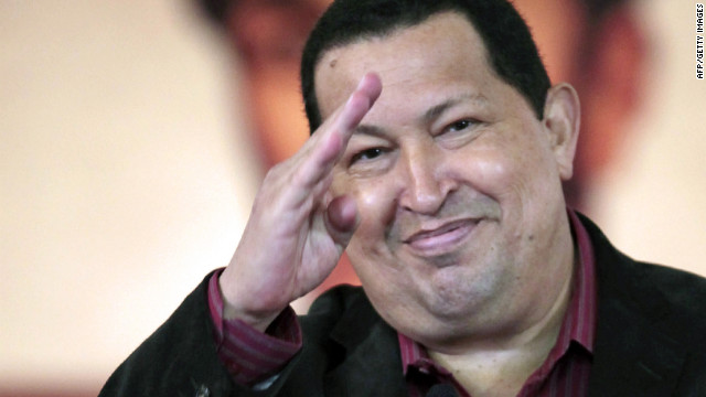 Venezuelan President Hugo Chavez gestures after signing a new labour law in Caracas on April, 30, 2012.