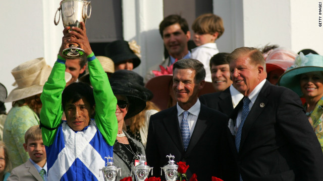 Matz looks on as jockey Edgar Prado celebrates Barbaro's commanding seven-length victory.