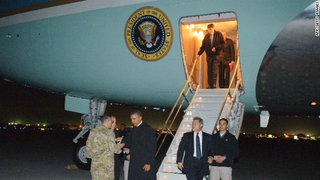 Obama greets U.S. Lt. Gen. Curtis Scaparrotti and U.S. Ambassador to Afghanistan Ryan Crocker at Bagram, some 50 kilometers north of Kabul, Afghanistan. 