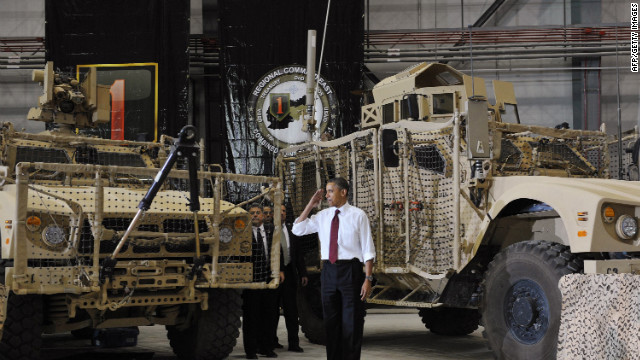Obama salutes troops at Bagram Air Base in Afghanistan. 