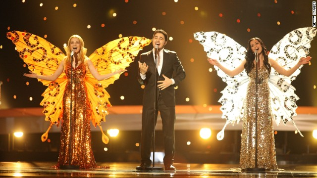"Representing Belarus in the country's second Eurovision appearance, the three female singers of the group 3+2 sprouted butterfly wings for the climactic key change in their song ""Butterflies."" They finished second to last."