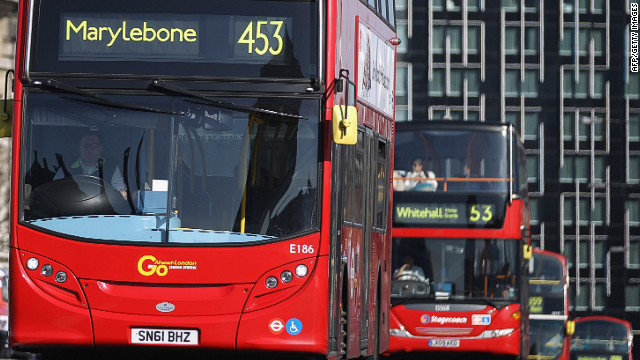 Double-decker buses make their way over Westminster Bridge in London in March. The iconic buses have been a wedge issue between the city's top contenders for mayor, incumbent Mayor Boris Johnson, the Conservative Party candidate, and Labour candidate Ken Livingstone, a former mayor. Both men have devoted their energies to transport -- and attacking each other on the issue.