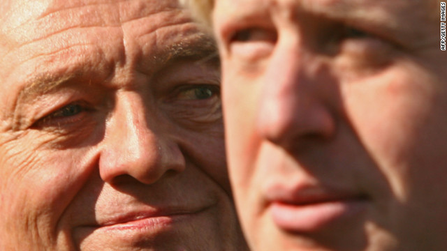 Mayoral candidates Ken Livingstone, left, and Boris Johnson look on as they attend a media event in April in London. Livingstone has pledged to cancel orders for more Routemaster double-deckers if Londoners vote him back into power, although he will allow the current eight buses to remain in service. Johnson, the incumbent, has pledged to put more of the double-deckers on the streets.