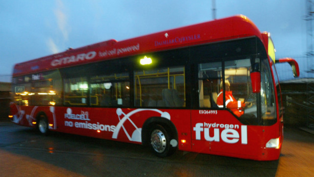 A hydrogen-powered bus is refuelled at a depot in London in 2004.
