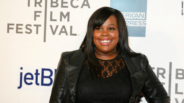 Amber Riley clears up rumors after red carpet collapse