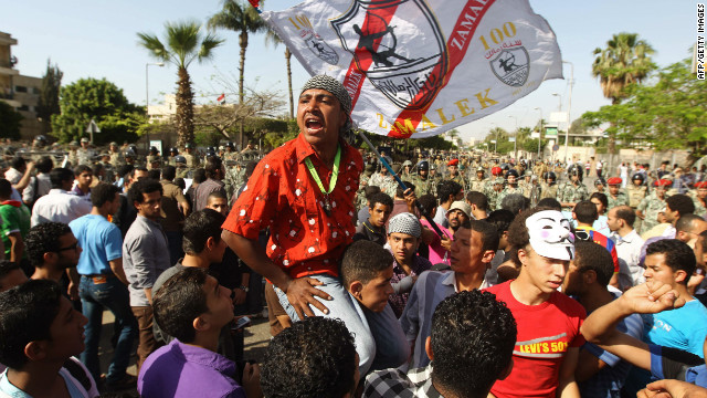Egyptians shout slogans during a demonstration against the interim military leadership outside the Defense Ministry in Cairo.