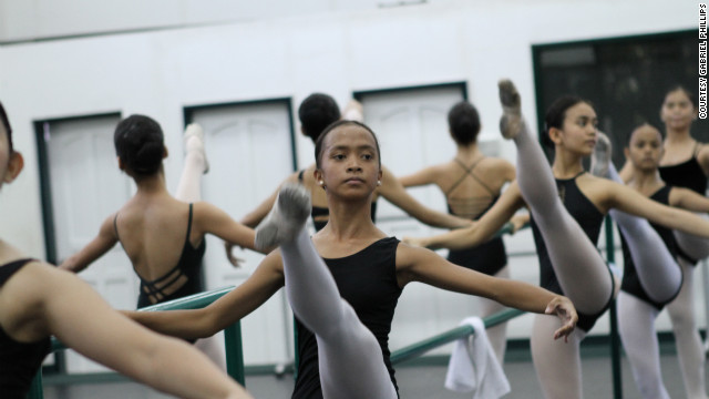 Jessa Balote at the bar of Ballet Manila with fellow aspiring ballerinas