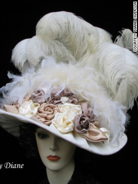 "A classic Derby design, Siverson's ""Triple Crown"" hat, is piled high with feathers and floral motifs. Large hats full of feathers are a nostalgic reminder of past years."